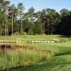 A sunny day view of a hole at Sea Trail Golf Resort and Convention Center.
