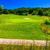 A sunny day view of a green at Salem Glen Country Club.