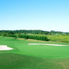 A view of a green protected by sand traps at Pointe Golf Club