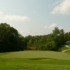 A view of a green with undulating path in background at Caswell Pines Golf Club