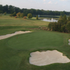 A view of a green surrounded by bunkers at Cedarwood Country Club