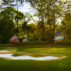 A view of hole #3 protected by tricky bunkers and spring trees at Irving Park from Greensboro Country Club