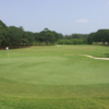 A view of a hole and a fairway at Oak Island Golf Club