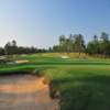 A view of green #18 protected by bunkers at Dormie Club