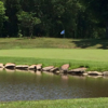 A view of a green with water coming into play at Lake Winds Golf Course
