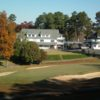 A view of a hole and the clubhouse in background at Badin Inn Golf Resort & Club