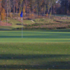 A fall day view of a green at UNC Finley Golf Club