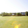 A sunny day view of a green at Carolina Meadows Golf Course.