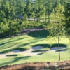 A sunny day view of a green from The Golf Club at Chapel Ridge.